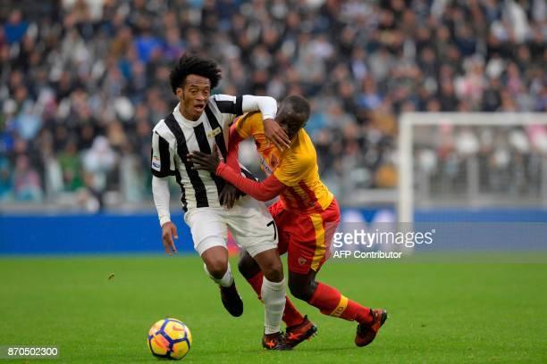 Juventus' Colombian forward Juan Cuadrado vies with Benevento's midfielder Raman Yussif Chibsah during the Italian Serie A football match Juventus vs...