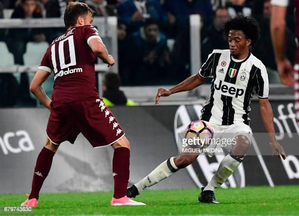 Juventus' Colombian forward Juan Cuadrado vies with Torino's Serbian forward Adem Ljajic during the Italian Serie A football match Juventus vs Torino...