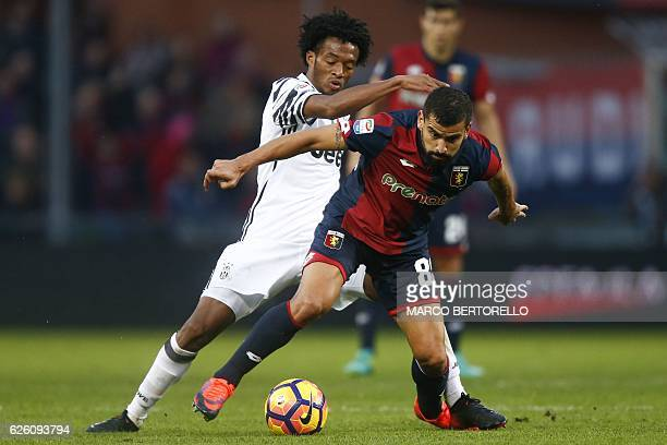 Juventus' Colombian midfielder Juan Cuadrado fights for the ball with Genoa's Venezuelan midfielder Tomas Rincon during the Italian Serie A football...