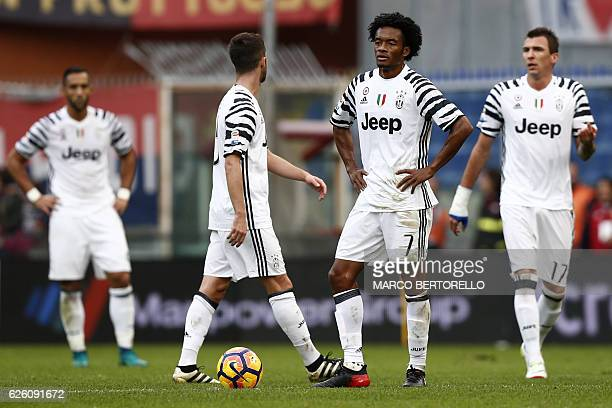 Juventus' Colombian midfielder Juan Cuadrado waits to pass the ball during the Italian Serie A football match between Genoa and Juventus at the Luigi...