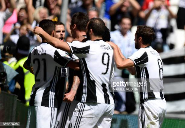Juventus' Croatian forward Mario Mandzukic celebrates with teammates after scoring during the Italian Serie A football match Juventus vs Crotone at...