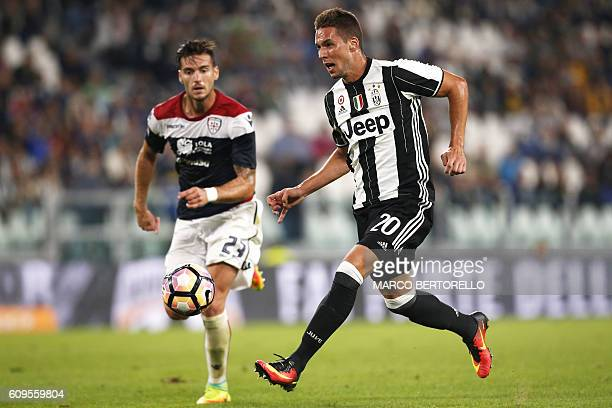 Juventus' Croatian midfielder Marko Pjaca vies for the ball with Cagliari's defender Luca Ceppitelli during the Italian Serie A football match...