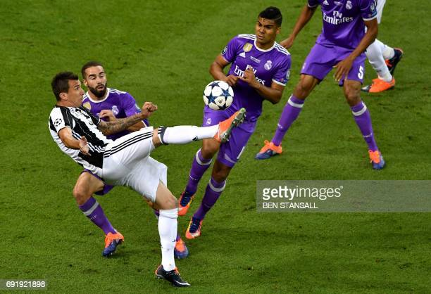Juventus' Croatian striker Mario Mandzukic scores a goal during the UEFA Champions League final football match between Juventus and Real Madrid at...
