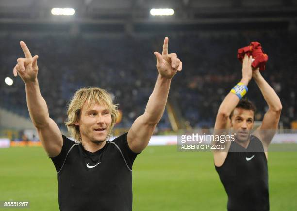 Juventus Czech midfielder Pavel Nedved and Juventus forward Alessandro Del Piero wave to supporters at the end of their Italian Serie A football...
