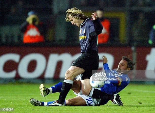 Juventus Czech midfielder Pavel Nedved is tackled by Brescia forward Roberto Baggio in Brescia 06 March 2004