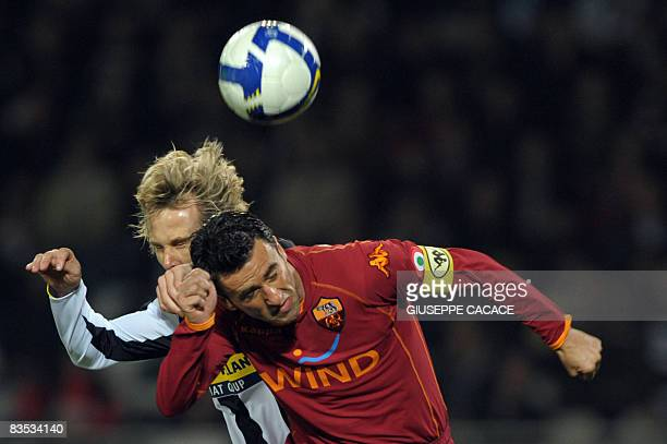 Juventus Czech midfielder Pavel Nedved jumps for the ball with AS Roma's defender Chistian Panucci during their 'Serie A' football match Juventus vs...