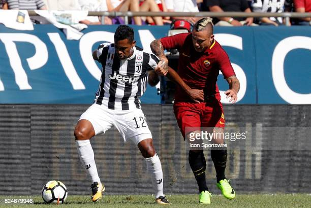 Juventus defender Alex Sandro fends off Roma midfielder Radja Nainggolan during an International Champions Cup match between AS Roma and Juventus on...