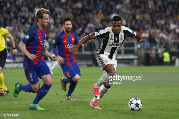 Juventus defender Alex Sandro fights for the ball against Barcelona midfielder Ivan Rakitic during the Uefa Champions League quarter finals football...