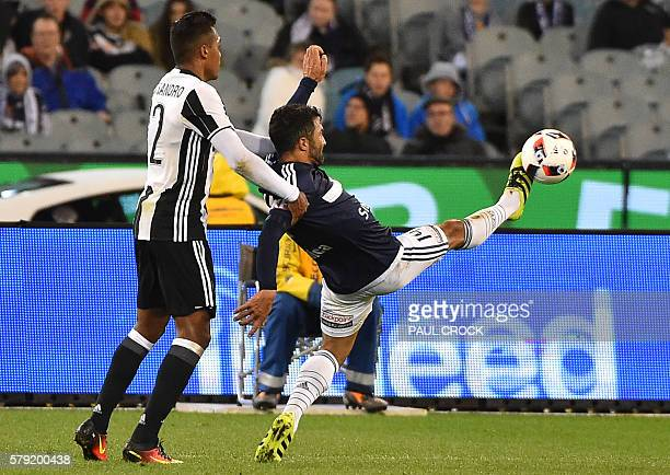 Juventus' defender Alex Sandro fights for the ball with Melbourne Victory's Fahid Ben Khalfallah during the International Champions Cup football...