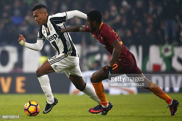 Juventus' defender Alex Sandro of Brazil vies with AS Roma's midfielder Gerson of Brazil during the Italian Serie A football match Juventus vs As...