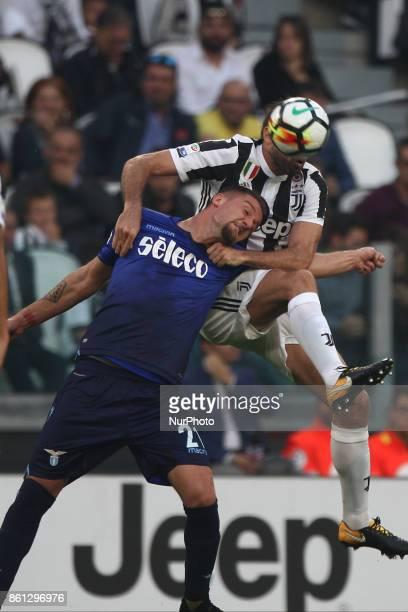 Juventus defender Andrea Barzagli and Lazio midfielder Sergej MilinkovicSavic head the ball during the Serie A football match n8 JUVENTUS LAZIO on at...
