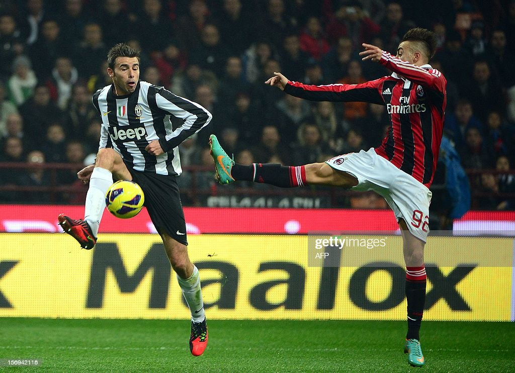 Juventus' defender Andrea Barzagli (L) fights for the ball with AC Milan's forward Stephan El Shaarawy during the Italian serie A football match between AC Milan and Juventus on November 25, 2012 at the San Siro stadium in Milan.