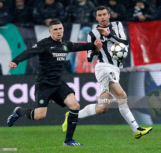 Juventus' defender Andrea Barzagli fights for the ball with Celtic's forward Gary Hooper during the Champions League match Juventus vs Celtic FC on...