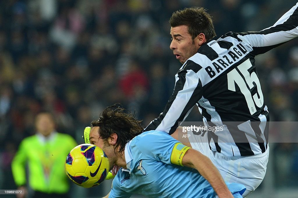 Juventus' defender Andrea Barzagli (R) vies with Lazio's midfielder Stefano Mauri during their TIM CUP football match between Juventus and Lazio at the 'Juventus Stadium' in Turin on January 22, 2013.