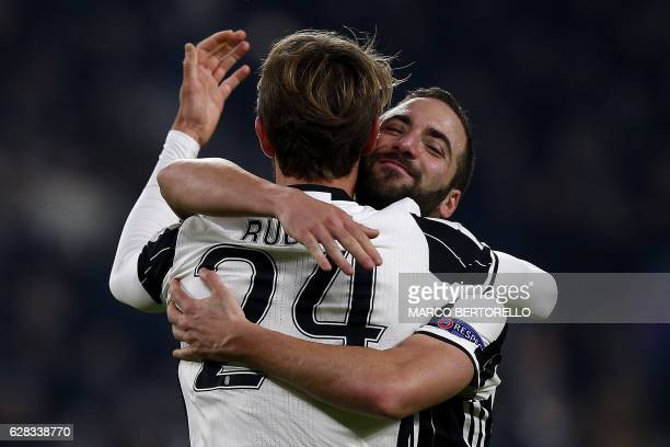 TOPSHOT Juventus' defender Daniele Rugani celebrates after scoring with Juventus' forward Gonzalo Higuain from Argentina during the UEFA Champions...
