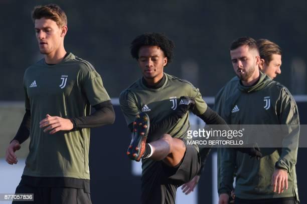 Juventus' defender Daniele Rugani Juventus' midfielder Juan Cuadrado from Colombia and Juventus' midfielder Miralem Pjanic of BosniaErzegovina attend...