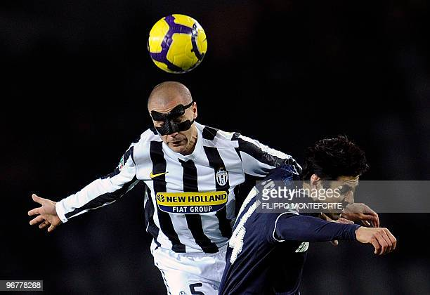 Juventus defender Fabio Cannavaro fights for the ball with Lazio's forward Julio Ruz during their Italian Serie A football match in Turin's Olympic...