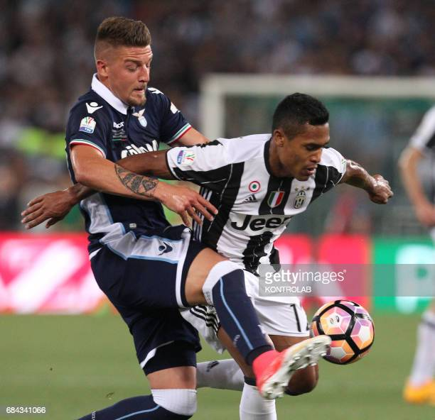 Juventus' defender from Brazil Alex Sandro fights for the ball with Lazio's midfielder from Serbia Sergej MilinkovicSavic during the TIM Italy Cup...