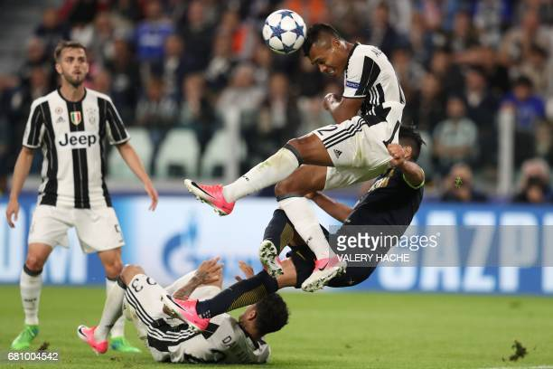 TOPSHOT Juventus' defender from Brazil Alex Sandro heads the ball during the UEFA Champions League semi final second leg football match Juventus vs...