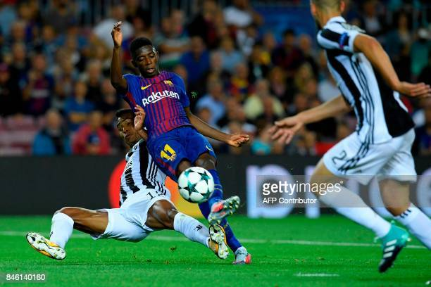 Juventus' defender from Brazil Alex Sandro vies with Barcelona's forward from France Ousmane Dembele during the UEFA Champions League Group D...