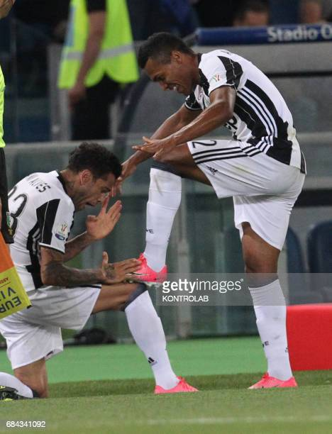 Juventus' defender from Brazil Dani Alves celebrates after scoring with teammate Juventus' defender from Brazil Alex Sandro during the TIM Italy Cup...