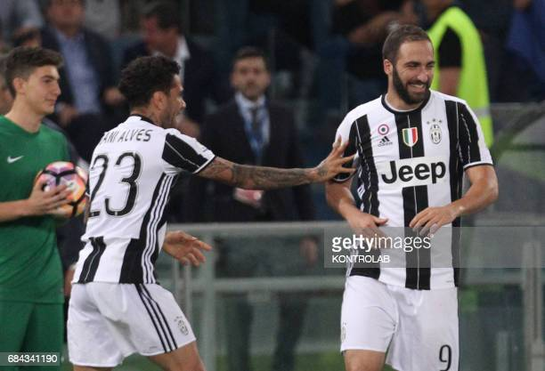 Juventus' defender from Brazil Dani Alves celebrates after scoring with teammate Juventus' forward from Argentina Gonzalo Higuain during the TIM...