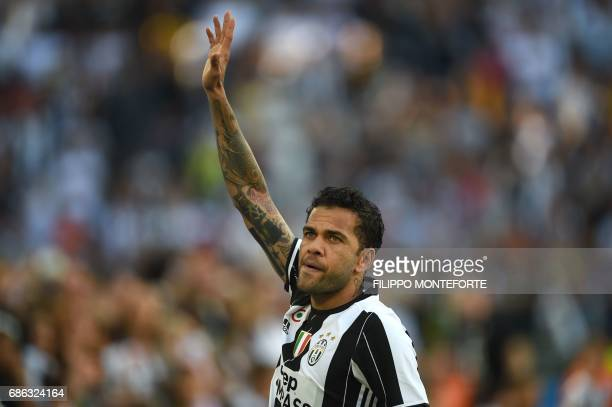 Juventus Defender from Brazil Dani Alves celebrates after winning the Italian Serie A football match Juventus vs Crotone and the 'Scudetto' at the...