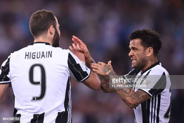 Juventus Defender from Brazil Dani Alves celebrates with Juventus' forward from Argentina Gonzalo Higuain during the Italian Tim Cup final on May 17...