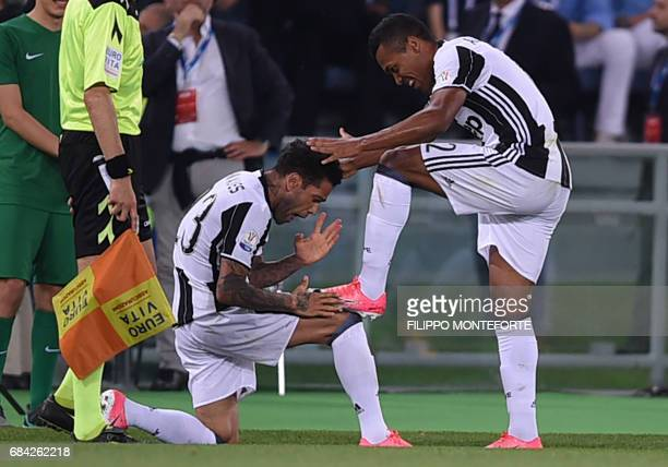 Juventus Defender from Brazil Dani Alves celebrates with teammate Juventus' defender from Brazil Alex Sandro after scoring during the Italian Tim Cup...