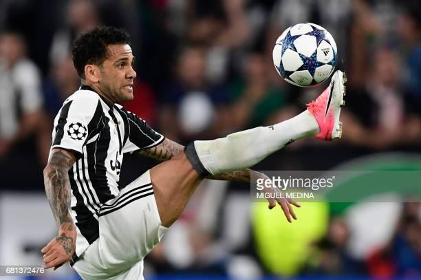 Juventus Defender from Brazil Dani Alves controls the ball during the UEFA Champions League semi final second leg football match Juventus vs Monaco...