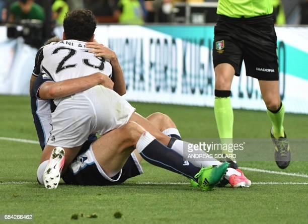 Juventus Defender from Brazil Dani Alves falls on Lazio's midfielder from BosniaHerzegovina Senad Lulic during the Italian Tim Cup final on May 17...