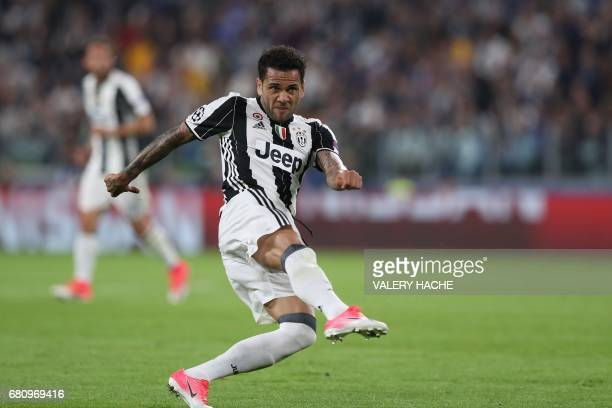Juventus Defender from Brazil Dani Alves kicks to score during the UEFA Champions League semi final second leg football match Juventus vs Monaco on...
