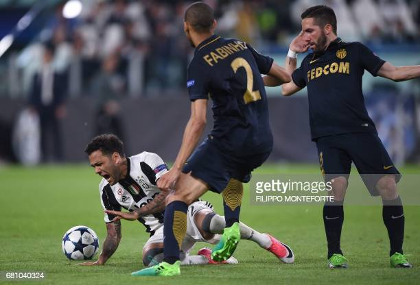 Juventus Defender from Brazil Dani Alves reacts next to Monaco's Brazilian defender Fabinho and Monaco's Portuguese midfielder Joao Moutinho during...