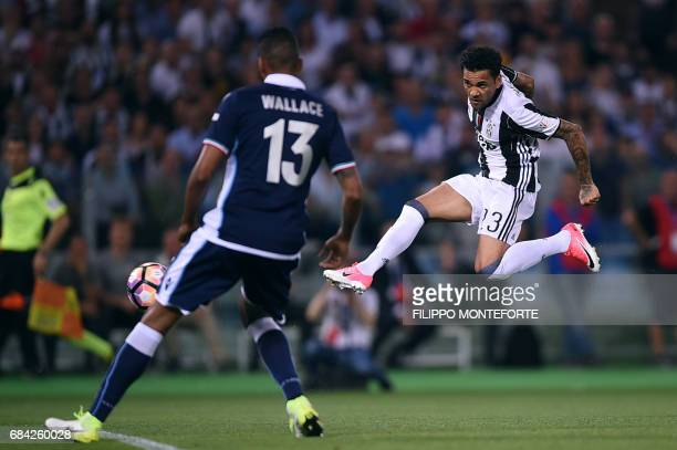 TOPSHOT Juventus Defender from Brazil Dani Alves scores during the Italian Tim Cup final on May 17 2017 at the Olympic stadium in Rome / AFP PHOTO /...