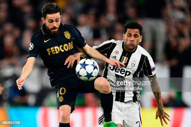 Juventus Defender from Brazil Dani Alves vies with Monaco's Portuguese midfielder Bernardo Silva during the UEFA Champions League semi final second...