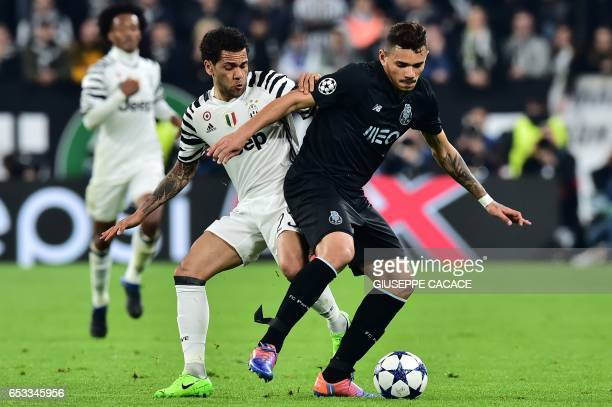 Juventus Defender from Brazil Dani Alves vies with Porto's forward from Brazil Tiquinho Soarez during the UEFA Champions League football match...