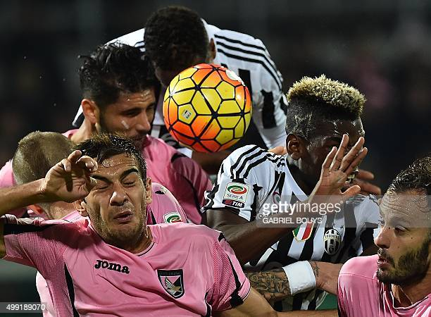 Juventus' defender from France Patrice Evra and Juventus' midfielder from France Paul Pogba vies with Palermo's defenders during the Italian Serie A...