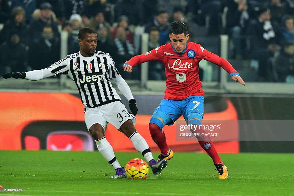 Juventus' defender from France Patrice Evra(L) fights for the ball with Napoli's midfielder from Morocco Omar El Kaddouri during the Italian Serie A football match Juventus vs Napoli at Juventus Stadium in Turin on February 13, 2016. / AFP / GIUSEPPE CACACE