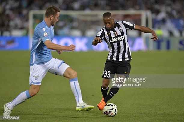 Juventus' defender from France Patrice Evra vies with Lazio's defender from Netherlands Stefan de Vrij during the Italian Tim Cup final match between...