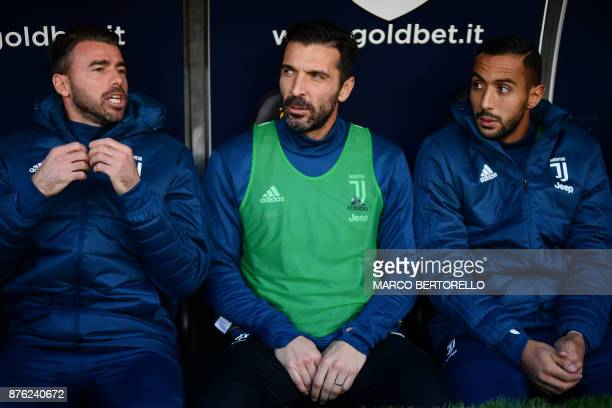 Juventus' defender from Italy Andrea Barzagli Juventus' goalkeeper from Italy Gianluigi Buffon and Juventus' defender Medhi Benatia are pictured on...