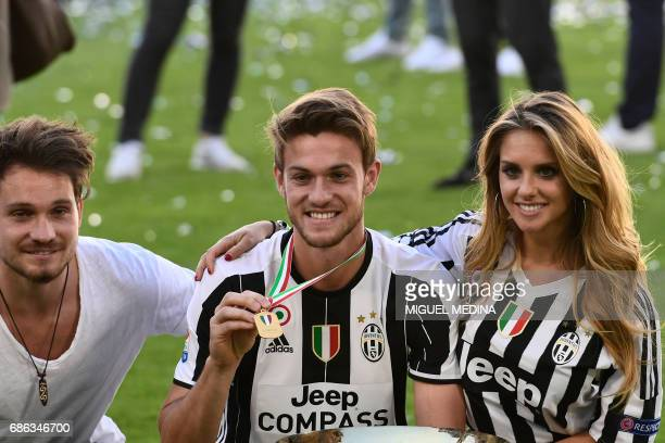 Juventus' defender from Italy Daniele Rugani poses with the trophy after winning the Italian Serie A football match Juventus vs Crotone and the...