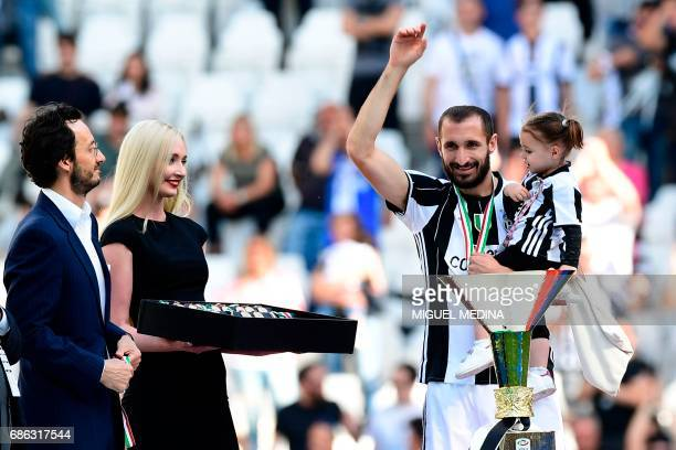 Juventus' defender from Italy Giorgio Chiellini celebrates on the podium after winning the Italian Serie A football match Juventus vs Crotone and the...