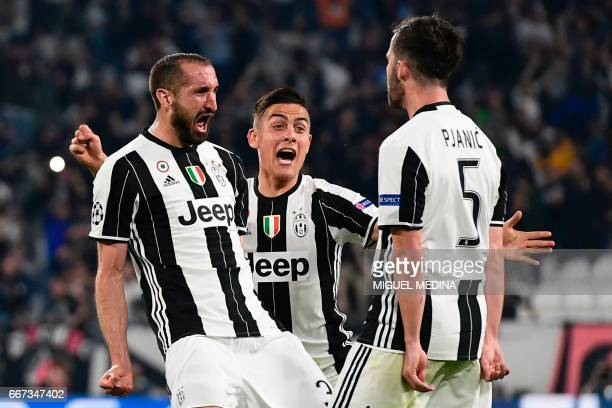 Juventus' defender from Italy Giorgio Chiellini celebrates with teammates Juventus midfielder Miralem Pjanic and Juventus' forward from Argentina...