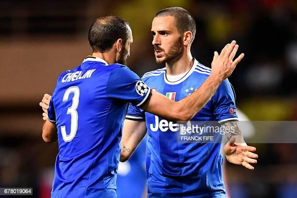 Juventus' defender from Italy Giorgio Chiellini congratulates Juventus' defender from Italy Leonardo Bonucci after their 20 win over Monaco in the...