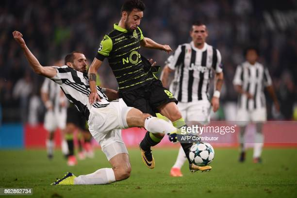 Juventus' defender from Italy Giorgio Chiellini fights for the ball with Sporting's midfielder Bruno Fernandes during the UEFA Champions League Group...