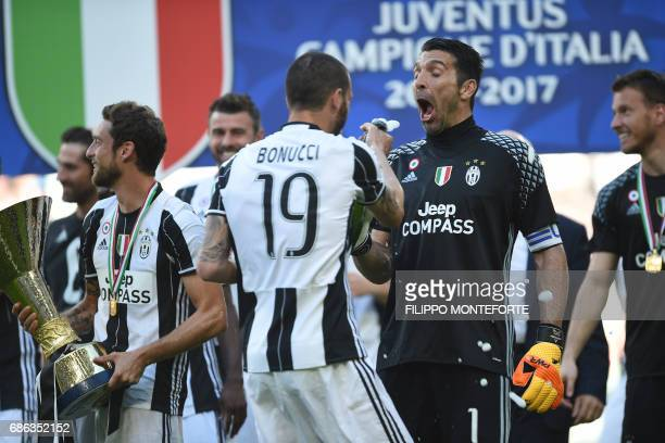Juventus' defender from Italy Leonardo Bonucci celebrates with Juventus' goalkeeper from Italy Gianluigi Buffon after winning the Italian Serie A...