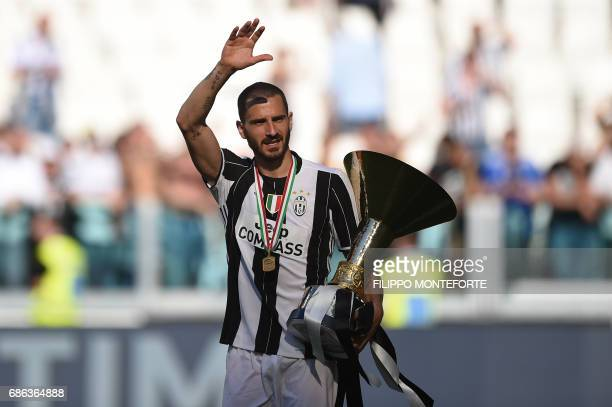 Juventus' defender from Italy Leonardo Bonucci holds the trophy after winning the Italian Serie A football match Juventus vs Crotone and the...