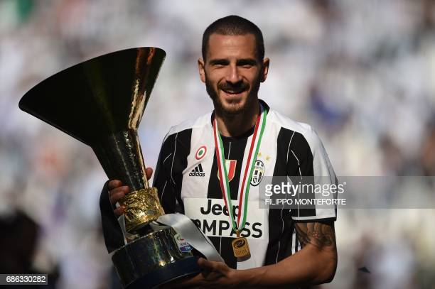 Juventus' defender from Italy Leonardo Bonucci poses with the trophy after winning the Italian Serie A football match Juventus vs Crotone and the...