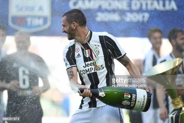 Juventus' defender from Italy Leonardo Bonucci sprays Prosecco as he celebrates after winning the Italian Serie A football match Juventus vs Crotone...