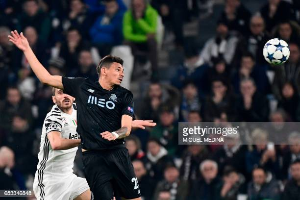 Juventus' defender from Italy Leonardo Bonucci vies with Porto's Brazilian midfielder Otavio during the UEFA Champions League football match Juventus...